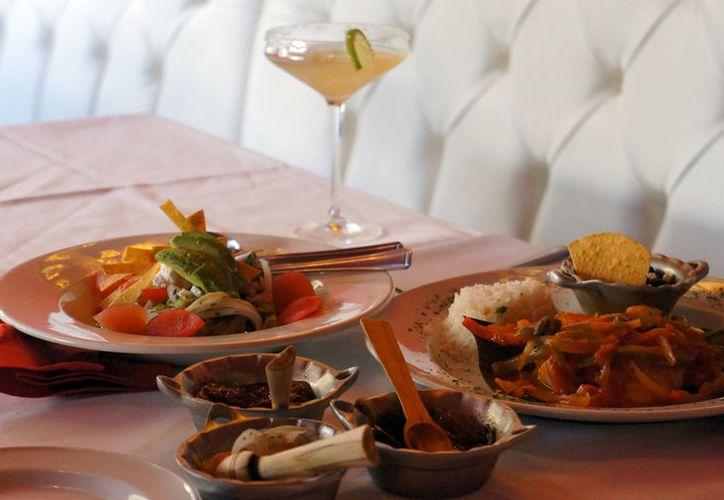 Los ingleses prefieren cada vez más la comida mexicana, en en especial los tacos, en donde el rey es de cochinita pibil, un guiso tradicional de la gastronomía yucateca. (Notimex)