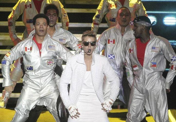 Justin Bieber sería detenido de inmediato si llegará a pisar tierras argentinas, luego de ser acusado por mandar a golpear a un fotógrafo.(Pablo Molina/AP)