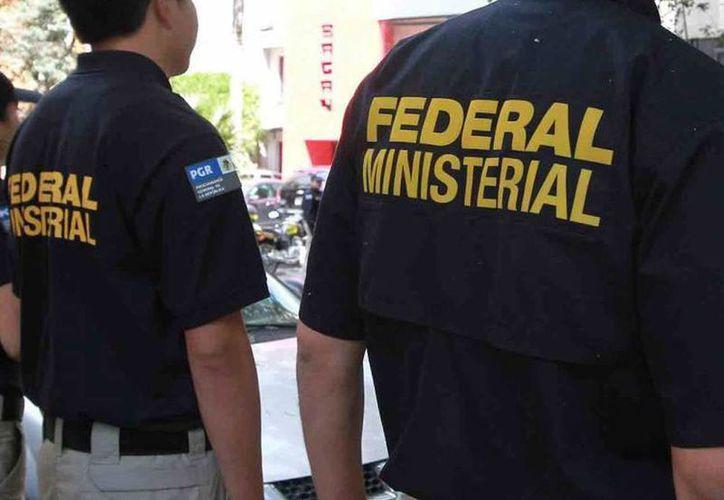 Las mujeres fueron detenidas por la Policía Ministerial acusadas de cometer un desfalco millonario. (Foto de contexto de archivo/Notimex)