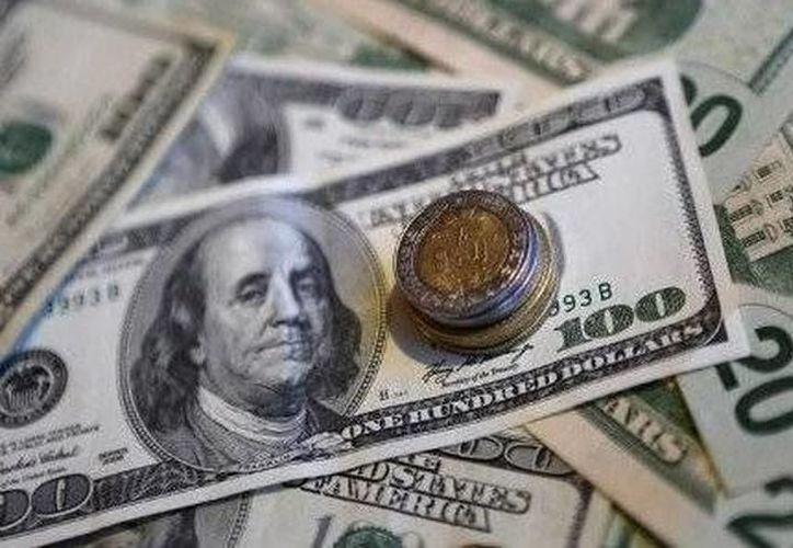 El Banco de México reportó que el dólar interbancario cerró en 20.702 unidades. (SIPSE)