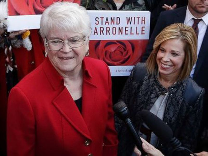 Barronelle Stutzman, left, a Richland, Wash., florist, smiles as she is surrounded by supporters after a hearing in Bellevue, Wash. (AP)