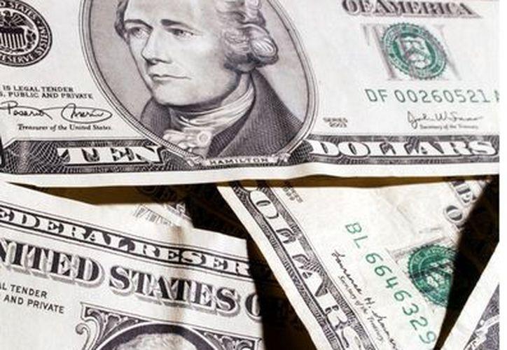 para la semana en curso, se espera que el dólar de la Unión Americana cotice entre 12.80-13.00 pesos. (Agencia Reforma)