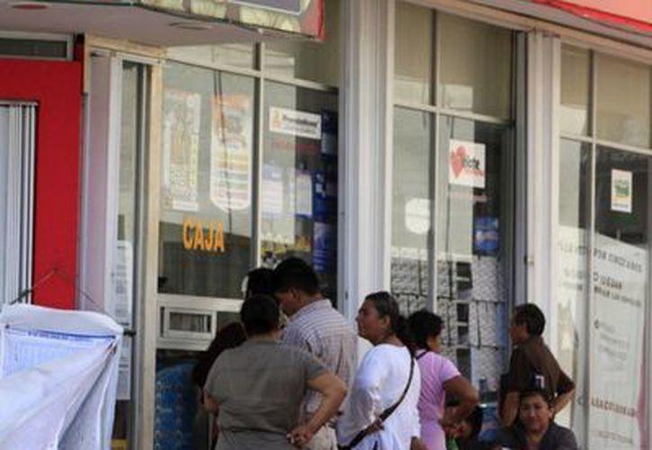 """La leyenda """"Chetumal, lugar donde inicia México"""", se verá en los billetes de la lotería del sorteo del 27 mayo.  (Harold Alcocer/SIPSE)"""