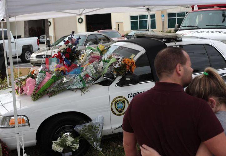 Este fin de semana fueron asesinados tres policías en EU: dos en Nueva York y uno en Florida. (AP)