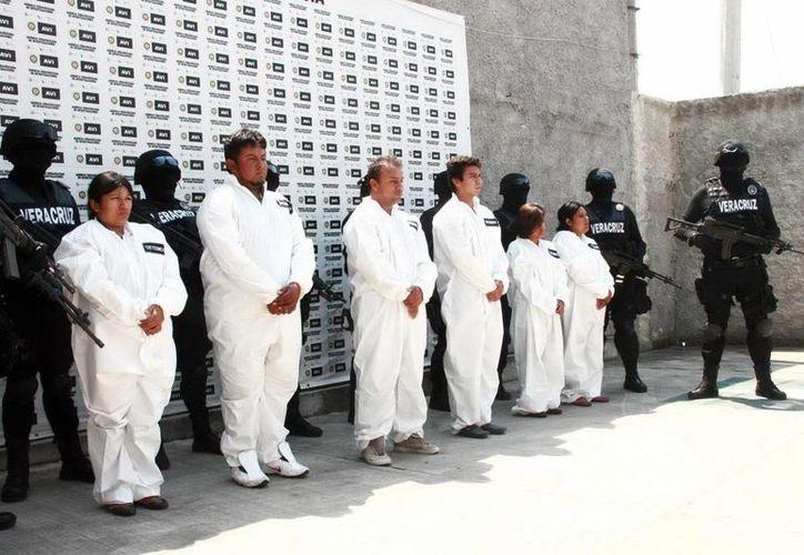 Aunque hay reducción de otros delitos, el plagio persiste. En la imagen, una banda de secuestradores capturada en Hidalgo. (Archivo/Notimex)
