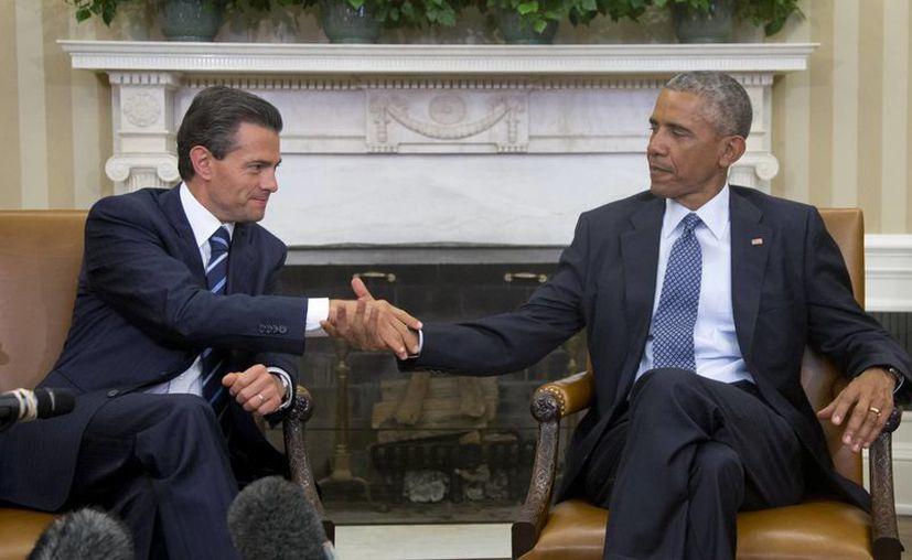 Los presidentes mexicano y estadounidense, Enrique Peña y Barack Obama, no solo hablaron sobre combatir y eliminar a los carteles de la droga, sino sobre la política migratoria. (Foto: AP)