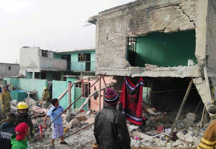 La explosión que se registró en Tultepec se debió a una acumulación de gas en el inmueble donde se manufacturaba pirotecnia artificial. (Notimex)