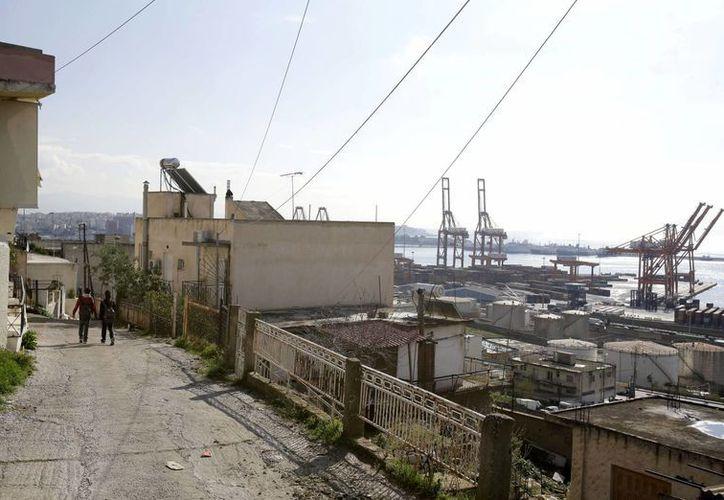 El poblado, de 30 mil personas, exhibe algunos de los peores síntomas de la crisis económica. (Agencias)