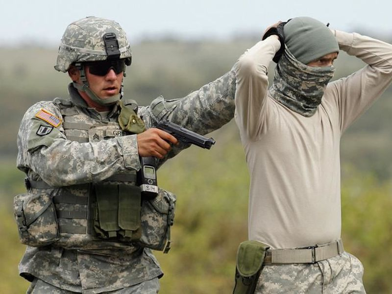 U.S. soldier in the the Deep Steel Task Force arrests a colleague in the role of a suspected terrorist during an exercise in the Babadag training area, Romania.
