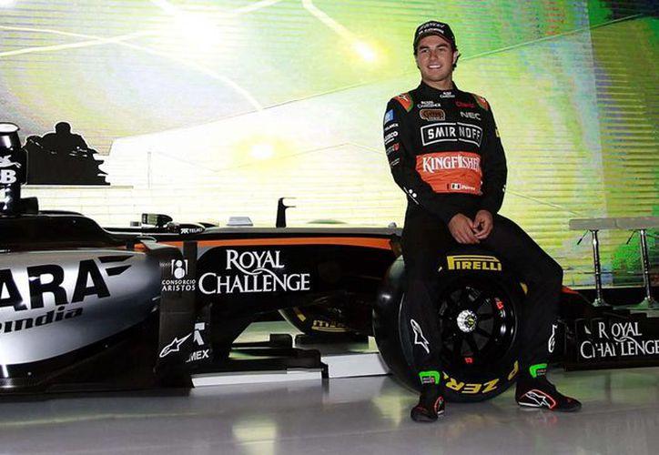 Hace unas semanas el piloto mexicano de Fórmula Uno, Sergio 'Checo' Pérez, despotricaba al decir que con el auto de carreras que usaba no podía llegar lejos. Hoy dice que podría ser el tercer mejor del mundo con Force India. (Foto de archivo tomada de .posta.com.mx)
