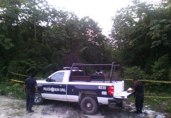 El cadáver de un joven fue encontrado con signos del crimen organizado en la carretera federal Felipe Carrillo Puerto – Tulum.(Redacción/SIPSE)