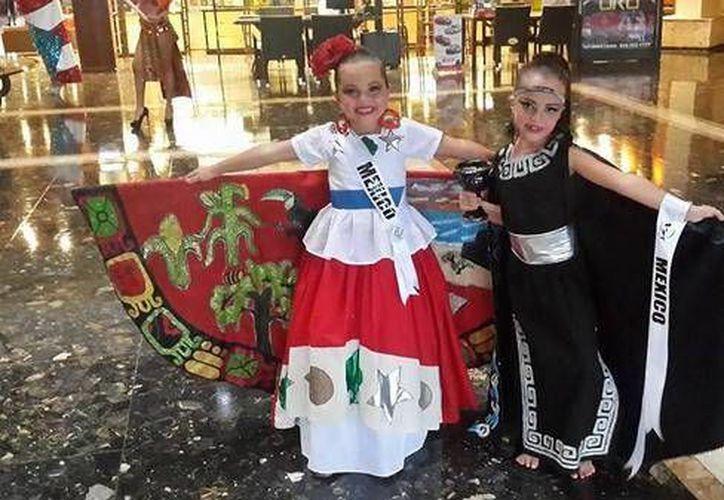Las cancunenses, Tade y Monse, resultaron ganadoras en el Miss Beauty World International 2014. (@jvite/Twitter)