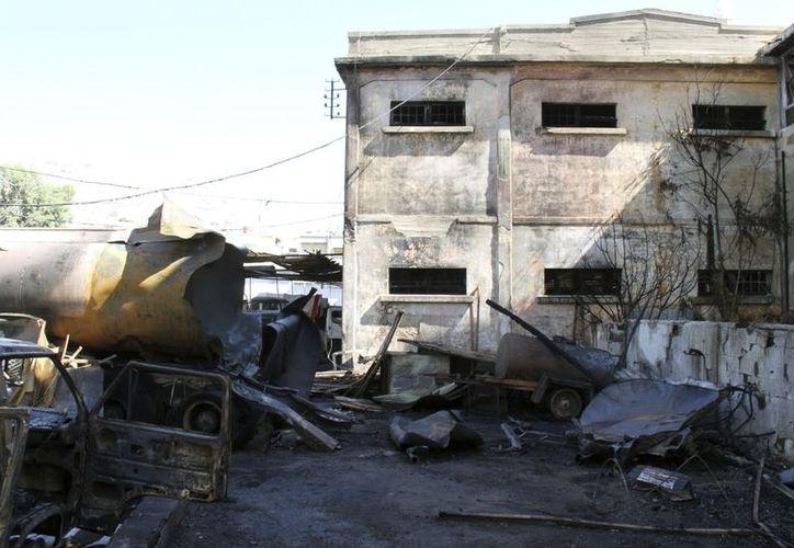 El atentado con coche bomba se registró en el barrio de Al Fahama. (EFE)
