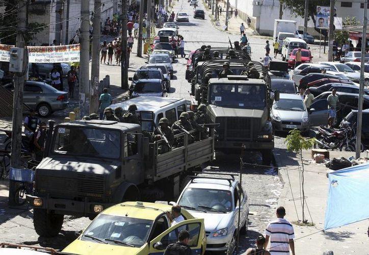 La política de pacificación, puesta en marcha en 2008, ha permitido instalar Unidades de Policía Pacificadora, en 38 favelas que eran controladas por narcos. (EFE/Archivo)