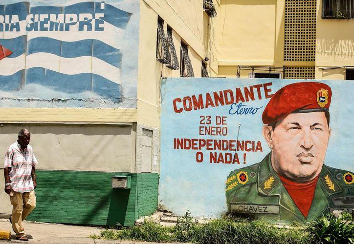 Chávez fue, junto con el líder cubano Fidel Castro, fundador del ALBA. (Foto: El Comercio)