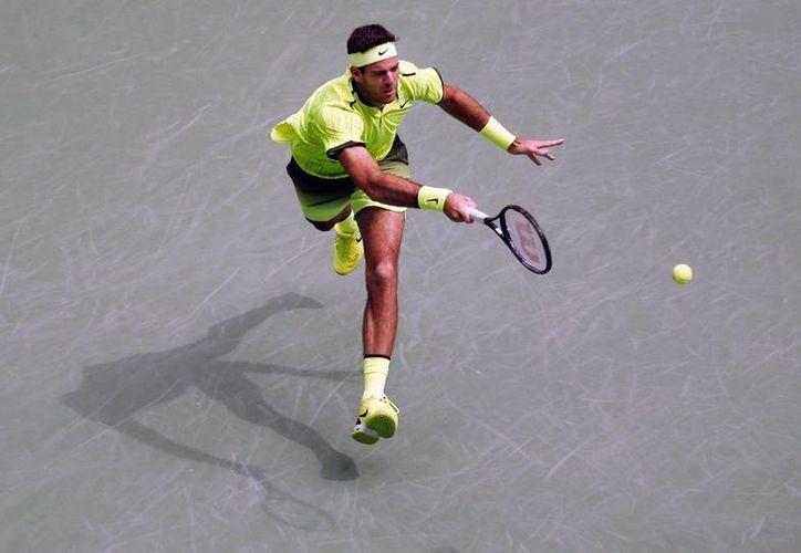 Juan Martin del Potro avanzó a la siguiente ronda del US Open 2016 porque su rival, Dominic Thiem, tuvo que abandonar el partido. (AP)