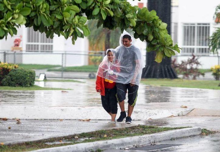 Algunas zonas de Mérida registraron intensas precipitaciones este domingo. (Milenio Novedades)