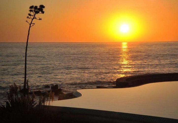 Los atardeceres son un regalo para todo el que visite Ensenada, Baja California, considerada entre las diez ciudades más románticas de México. (Notimex)