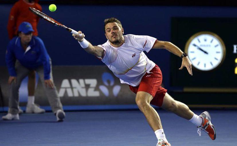 Tras eliminar a Djokovic en cuartos de final y a Berdych en semifinal, Wawrinka (foto) jugará el partido decisivo contra Federer, campeón del Abierto de Australia en 2010, o Nadal, en 2009. (Agencias)