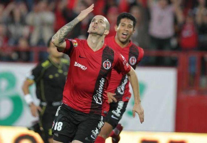Benedetto marcó tres goles en su debut soñado ante Xolos. (frontera.info)