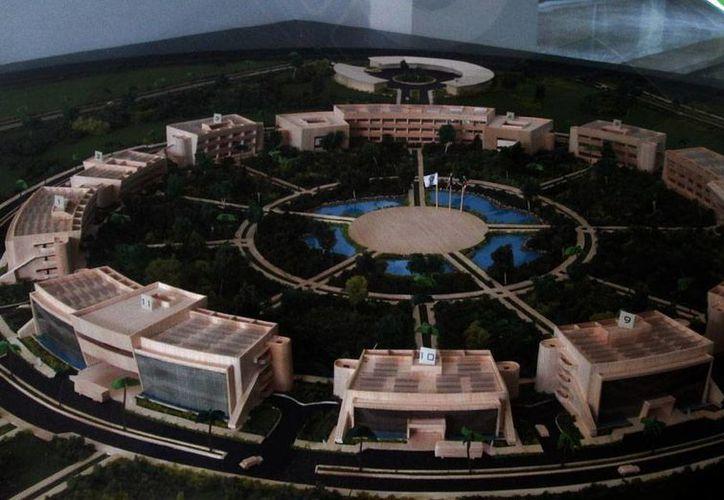 Al Cinvestav Yucatán le recortaron poco más de 23 por ciento de su presupuesto para 2015. La imagen es de la maqueta del nuevo edificio del centro que se construye en el parque científico. (Milenio Novedades)