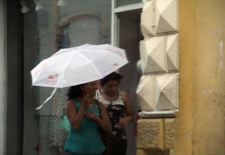 Pronostican más lluvias en los próximos días en Yucatán aunque la temperatura puede llegar a los 36 grados. (SIPSE)