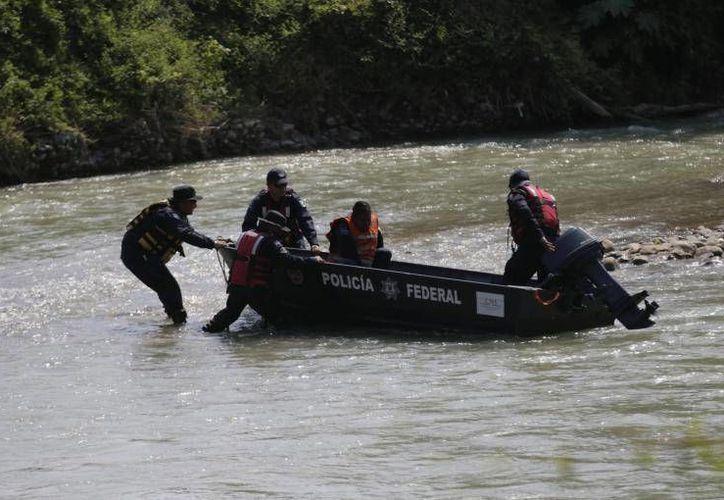 Las autoridades realizaron tareas de búsqueda en el río San Juan, donde se supone que fueron lanzados los restos de los normalistas de Ayotzinapa. (Archivo/Reuters)