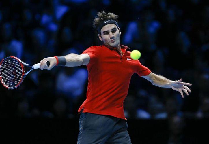 Roger Federer comenzó abajo 0-30 contra Andy Murray en la Copa Masters de la ATP, pero después  tomó el control del partido hasta el final. (Foto_ AP)