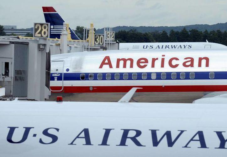 La nueva American dijo que planea mantener a sus clientes todos los servicios ofrecidos por American y US Airways. (Agencias)