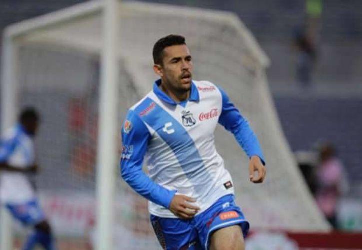 Hérculez Gómez consiguió el campeonato de goleo del torneo Bicentenario 2010, cuando defendía los colores del Puebla.(Notimex)