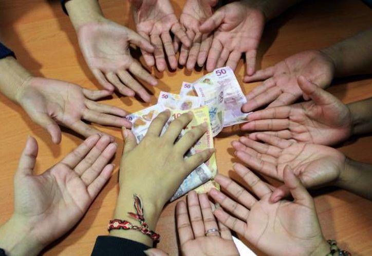 Antes de confiar el dinero a alguna institución, se debe verificar que esté debidamente autorizada y regulada por las autoridades. (Luis Soto/SIPSE)