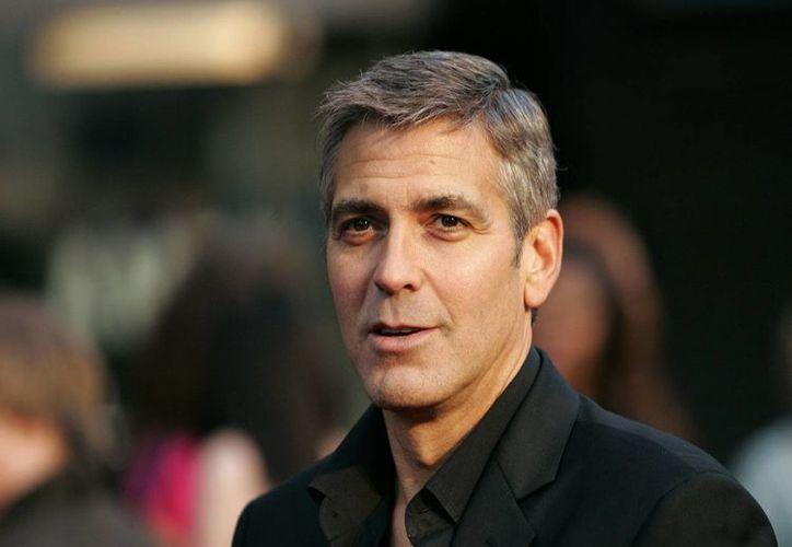 """Además de dedicarse a promocionar su tequila, Clooney trabaja ahora en el rodaje de """"The Monuments Men"""". (fanpop.com/Archivo)"""