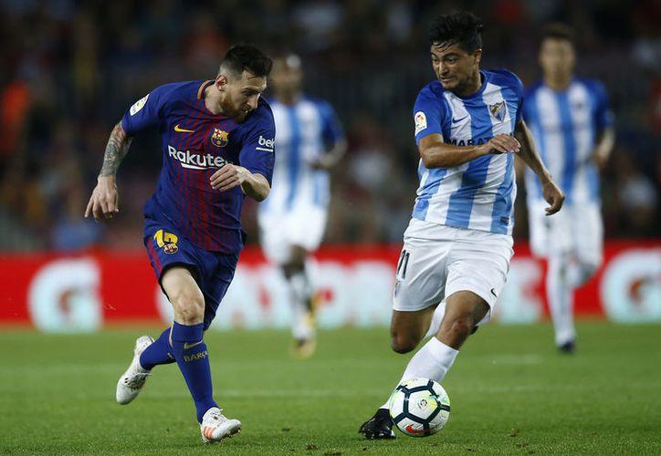 Con un gran pase de Messi, Andrés Iniesta recibió el esférico dentro del área grande. (Foto: AP)