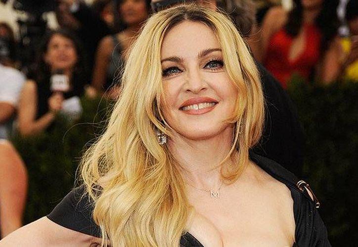 En los últimos días, Madonna se desnudó con la intención de promover el voto a favor de Hillary Clinton, candidata demócrata a la Presidencia de EU.(Foto tomada de Billboard.com)