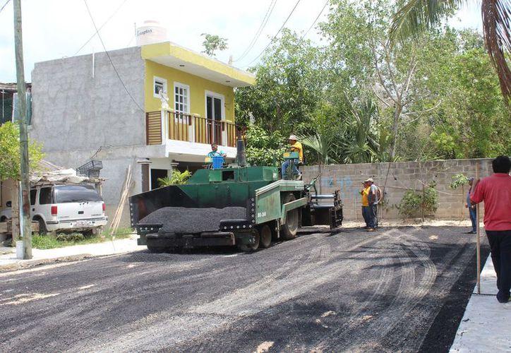 Tras la pavimentación de las calles en el fraccionamiento Huracanes, vecinos exigen más pozos de absorción para evitar inundaciones. (Foto: Sara Cauich/SIPSE)