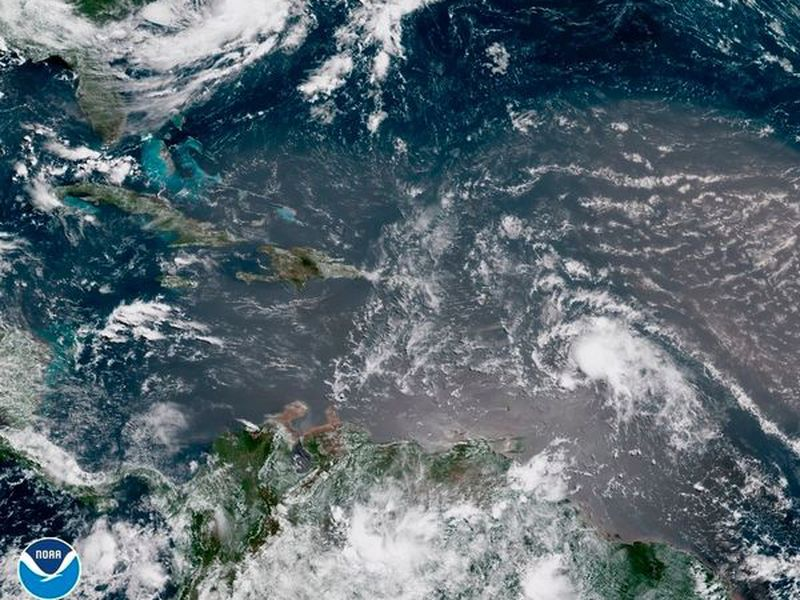 In this geocolor image GOES-16 satellite image taken Sunday, July 8, 2018, at 15:00 UTC, shows Tropical Storm Beryl, center right, moving across the Lesser Antilles in the eastern Caribbean.