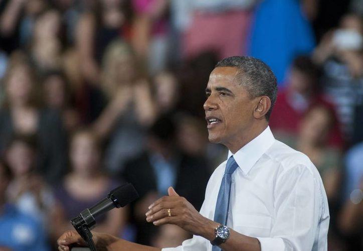 Obama preveía reunirse con Putin en Moscú antes de asistir a la cumbre del G20. (EFE)