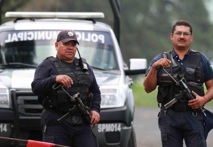 Los policías municipales se incorporarán a sus labores la próxima semana, indicó el oficial mayor de Michoacán. (Notimex)