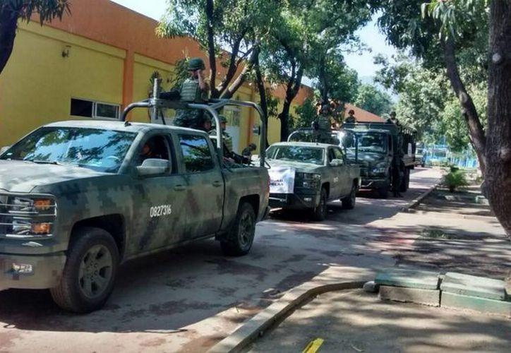 Elementos del Ejército Mexicano y  Marina Armada patrullaron el lugar después del ataque a policías federales. Foto de contexto de un grupo de militares. (Archivo/Notimex)