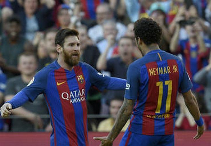 El cuadro catalán golea al Submarino Amarillo y mantiene el pulso por La Liga (Foto: AFP)