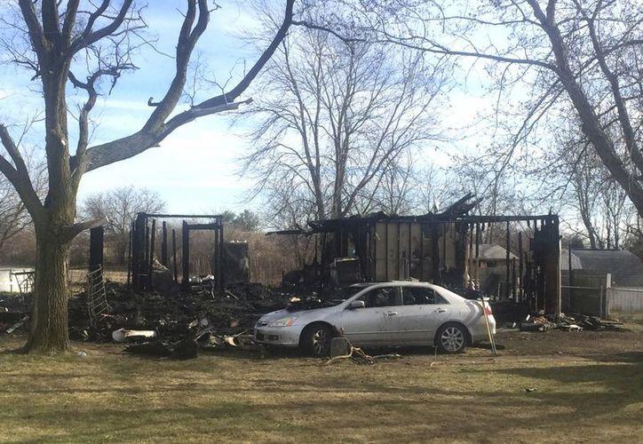 La escena de la casa donde una abuela y sus tres nietos murieron en un incendio en el condado de Fayette en Ohio. (Agencias)