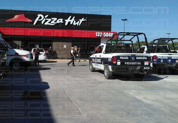Los elementos policíacos se trasladaron de inmediato al lugar. (Orville Peralta/SIPSE)