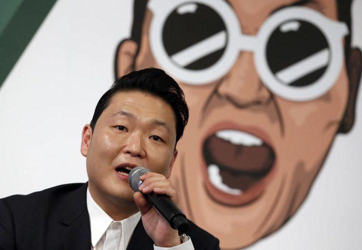 El rapero surcoreano PSY durante la presentación de su séptima producción discográfica, la cual será lanzada a nivel mundial este martes. (AP)