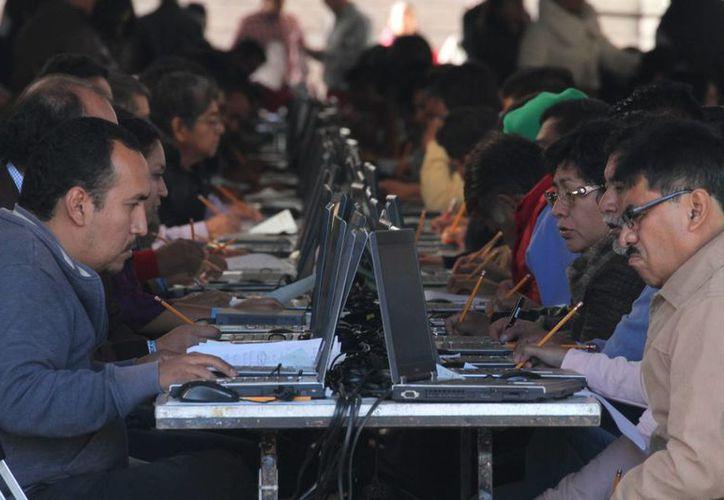 Los maestros que se presentaron al examen de servicio profesional docente en Oaxaca serán sancionados por la CNTE. (Notimex)