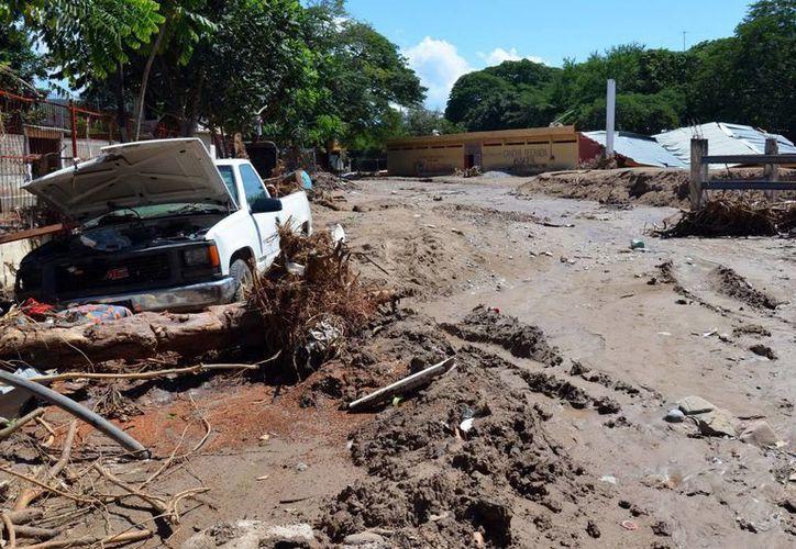 """Las comunidades en mayor riesgo están asentadas cerca de ríos, de cerros o de """"levantamientos del suelo"""". (Notimex)"""
