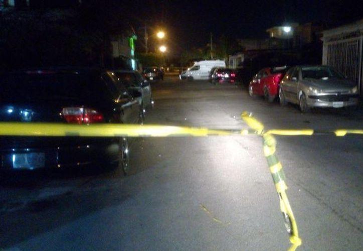 Un cadáver fue encontrado dentro de una bolsa esta noche en la Supermanzana 516 de Cancún. (Redacción/SIPSE)