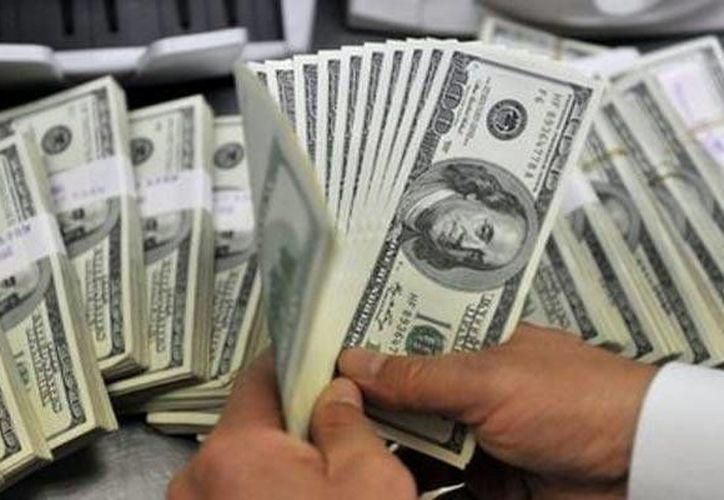En Mérida el dólar se compró a 12.45 pesos y se vendió en 12.90 pesos. (Archivo/AP)
