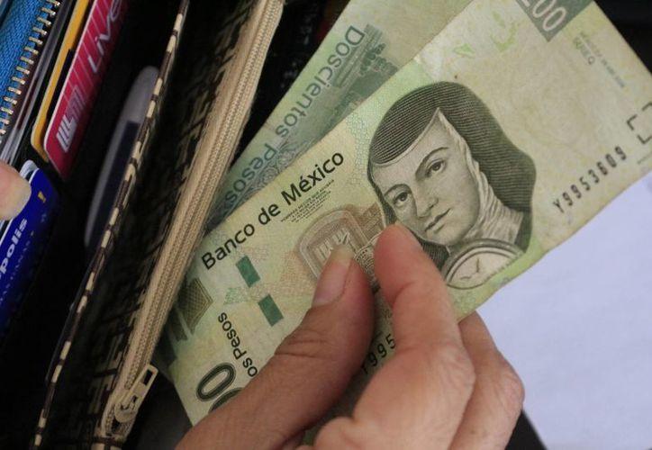 La Secretaría del Trabajo y Previsión Social inició la entrega de 900 requerimientos a personas físicas para que comprueben el pago de utilidades. (Gerardo Amaro/SIPSE)