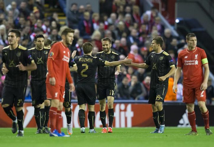 Ni con ventaja numérica, el Liverpool pudo doblegar al Rubin Kazán y empataron 1-1 en partido de la Europa League, este miércoles en el Estadio Anfield. (Imágenes de AP)