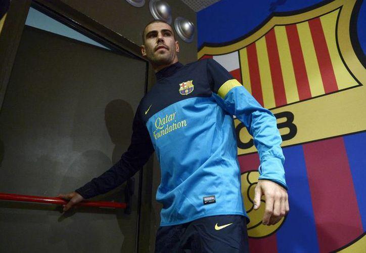El portero Víctor Valdés fue opertado de ligamentos cruzados en la segunda mitad de la temporada pasada. (AP)